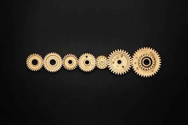 photo-of-golden-cogwheel-on-black-background-3785927